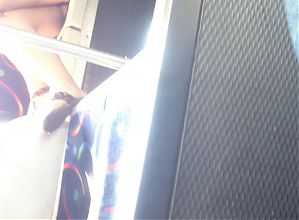 Young teen sitting upskirt in a bus