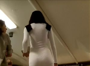 Dark haired beauty in tight white dress and hot face